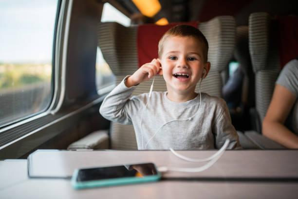 Little boy having fun in the train stock photo