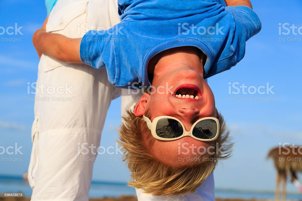 little boy having fun with dad on summer sky stock photo