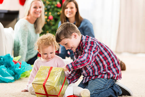 Royalty Free Brother And Sister Kids Opening Presents On Christmas ...