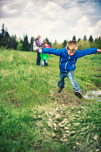 Cute Child Playing In Mud Stock Photo - Download Image Now