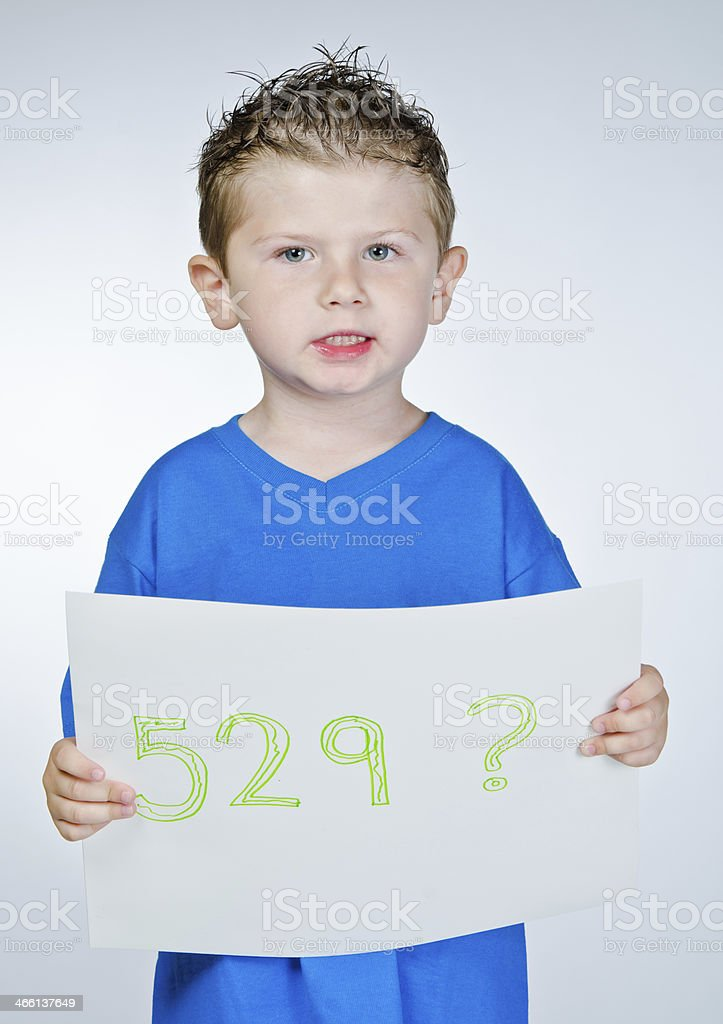 Little boy holding a 529 saving plan sign stock photo