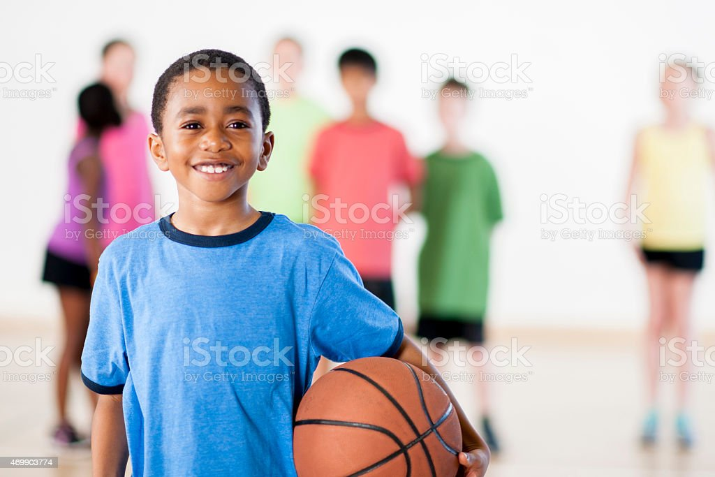Little boy holding a basketball stock photo