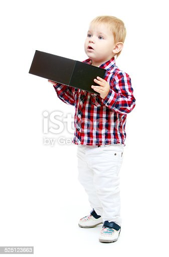 istock Little boy holding a big black box. 525123663