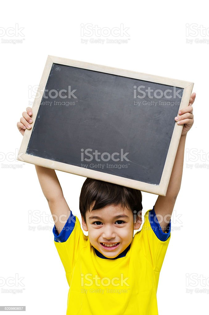 Little boy holding a blackboard over white background stock photo