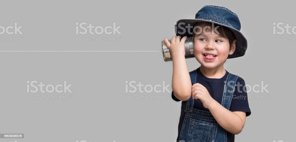 Little boy holding a can with a cord stock photo