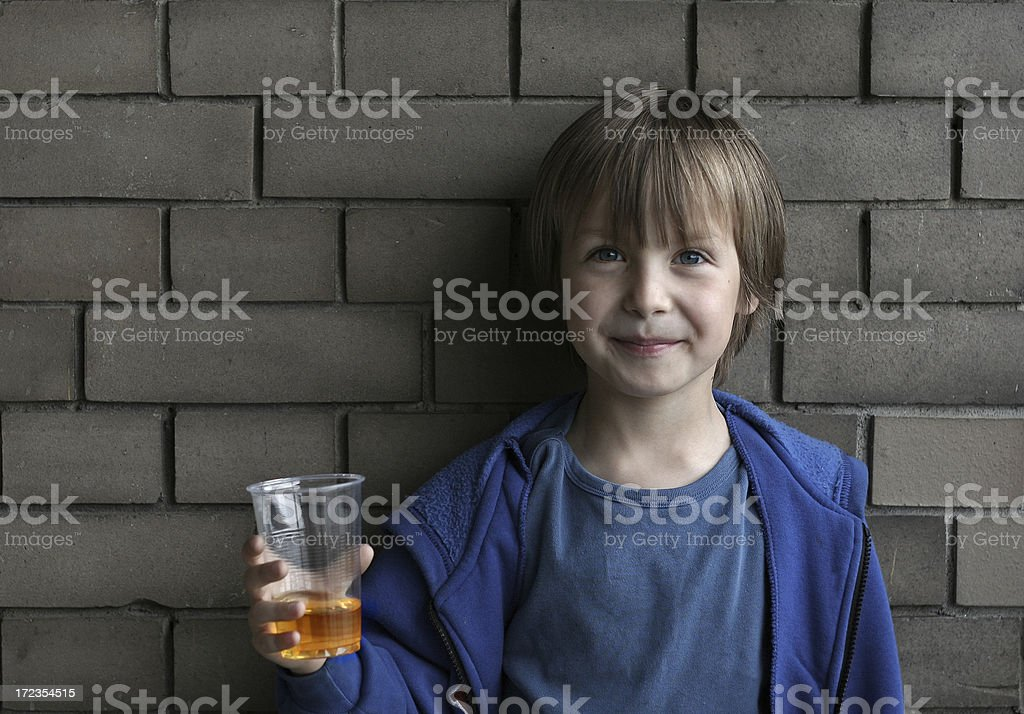 Little Boy holding a glass of Apple Juice royalty-free stock photo