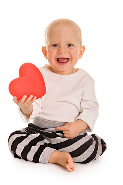 Little boy holding a heart stock photo