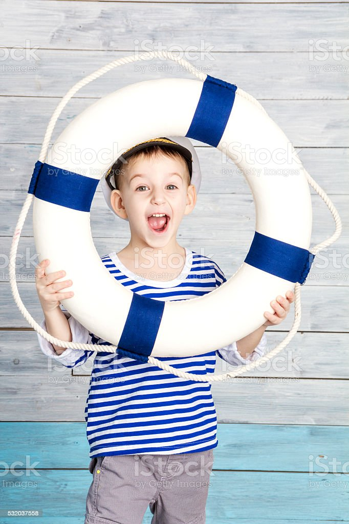 little boy holding a life preserver and screaming stock photo