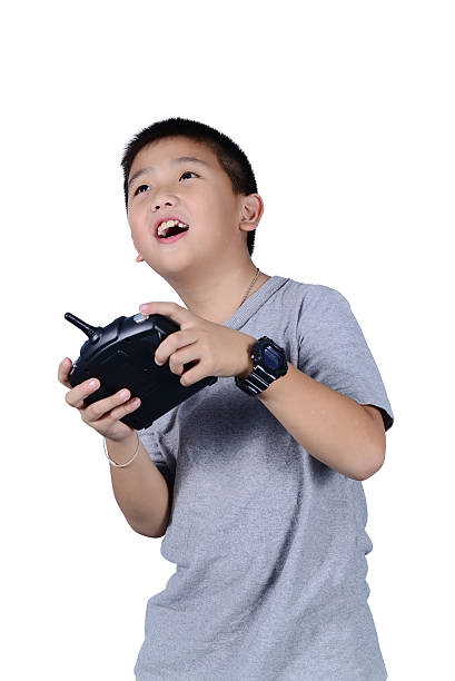 Little boy holding a radio remote control for helicopter, drone stok fotoğrafı