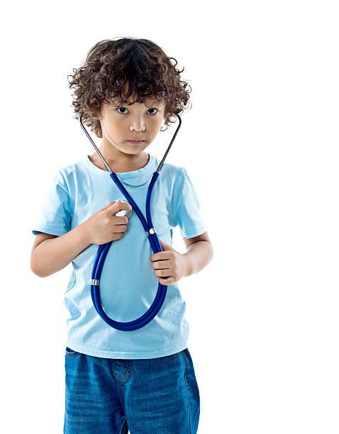 Little boy holding a stethoscope stock photo