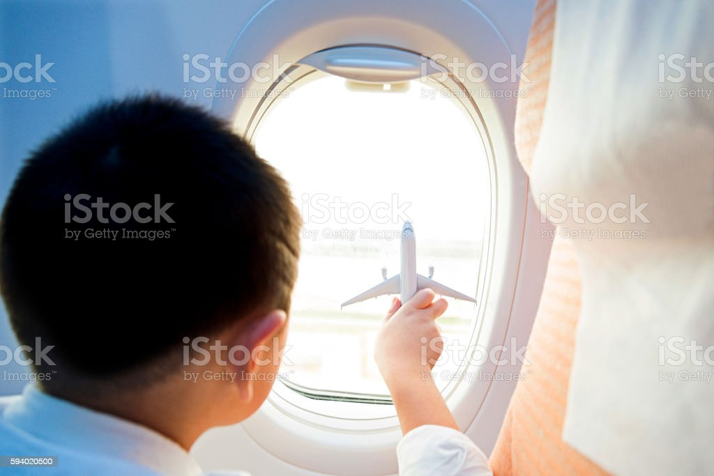 Little boy holding a toy plane stock photo