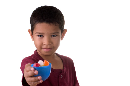 Little Boy Holding an Easter Egg with Candy