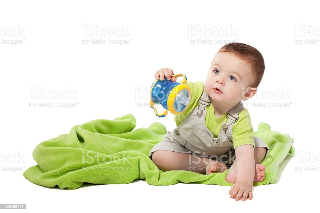Little boy holding baby cup stock photo