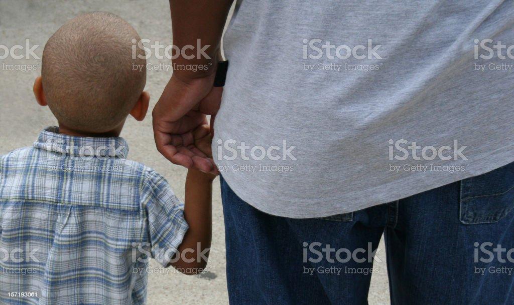 Little Boy Holding Dad's hand
