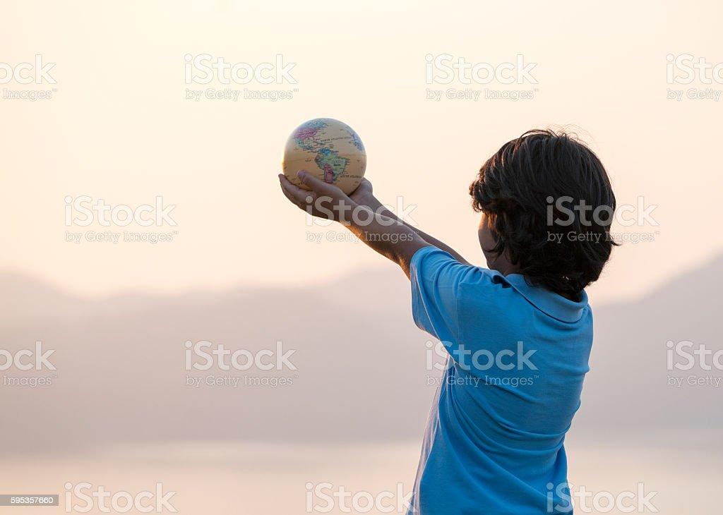 Little boy holding globe stock photo