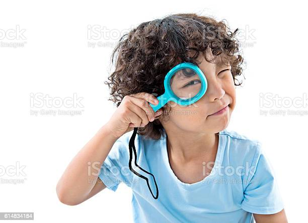 Little boy holding magnifying glass against white background picture id614834184?b=1&k=6&m=614834184&s=612x612&h=afakw jcdpto4t 5mnedlhuejhclpp5xw7fo89zxrmw=