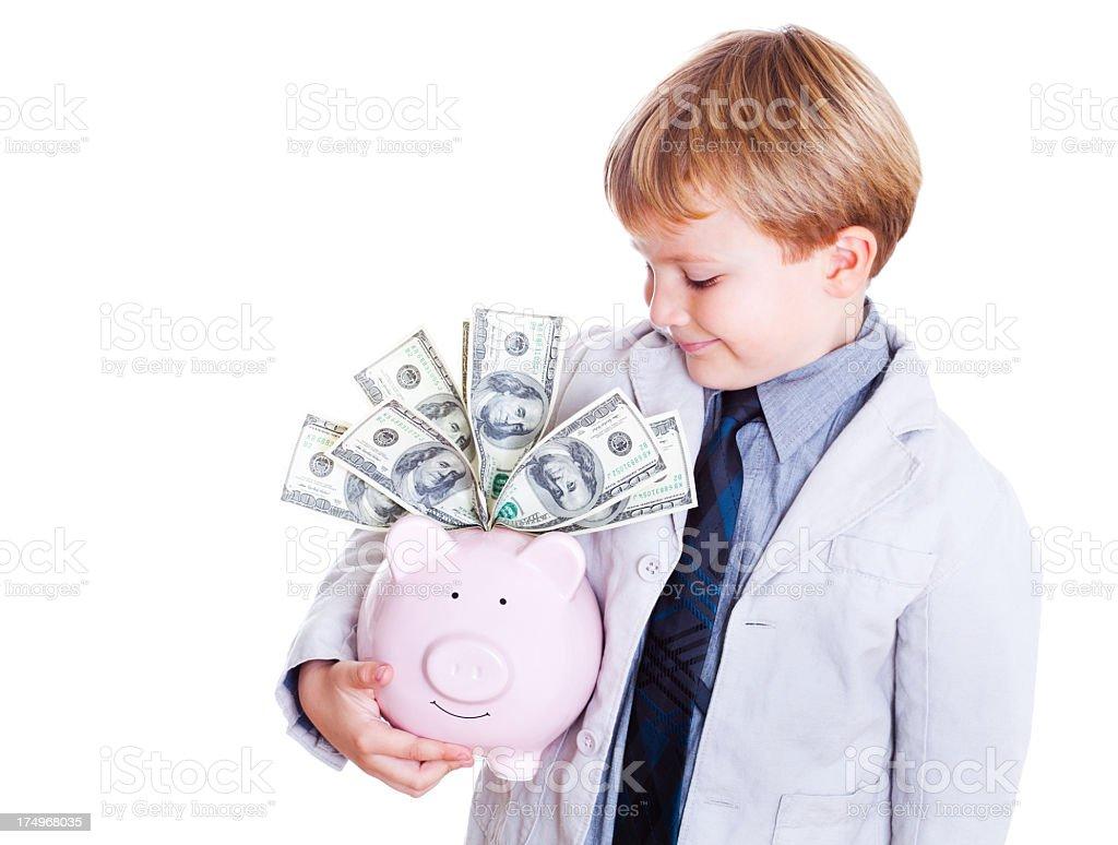 Little Boy Holding Piggy Bank royalty-free stock photo