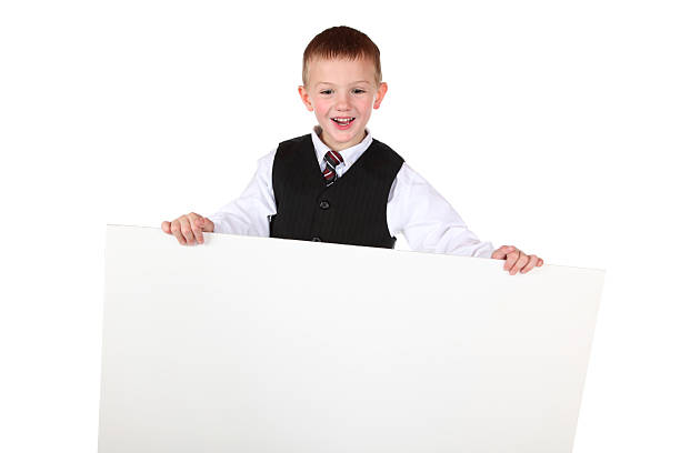 LIttle Boy Holding Sign stock photo