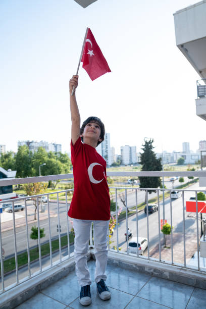 Little Boy Holding Turkish Flag For Celebration Of National Sovereignty And Children's Day stock photo