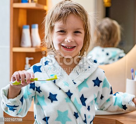 948443044 istock photo Little boy holds toothbrush with paste 1222107759