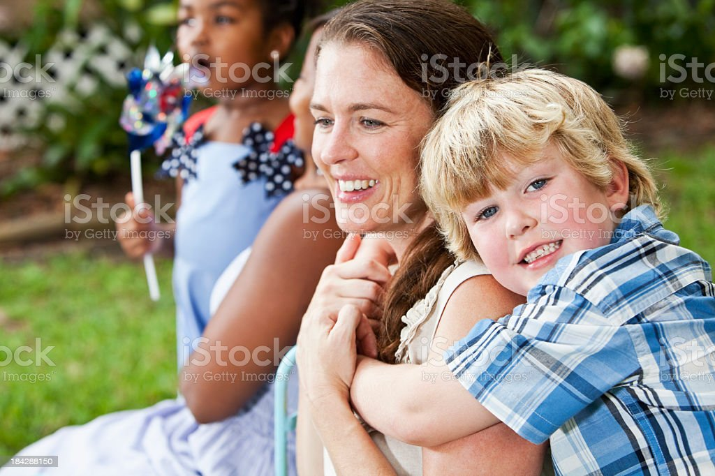 Little boy hugging mother stock photo