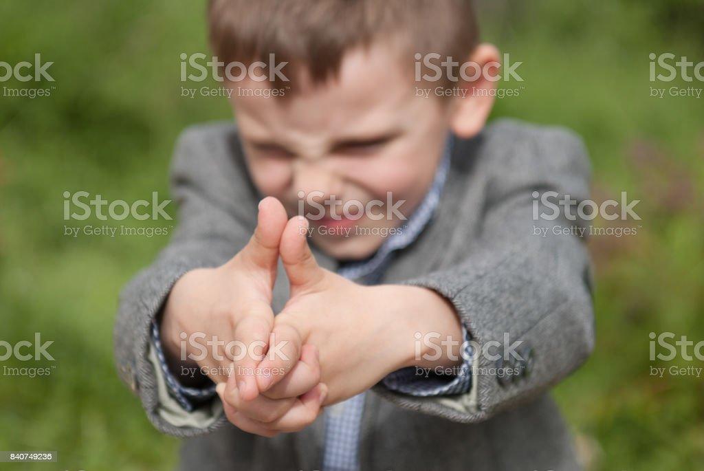 Little boy imitates a gun stock photo