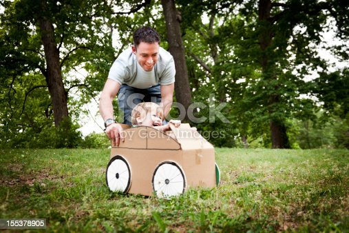 496487362 istock photo Little Boy in a Cardboard Car 155378905