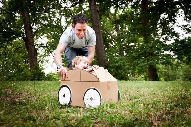 Little Boy in a Cardboard Car stock photo