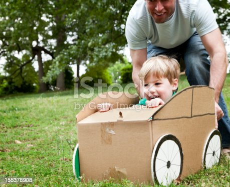 496487362 istock photo Little Boy in a Cardboard Car 155378908