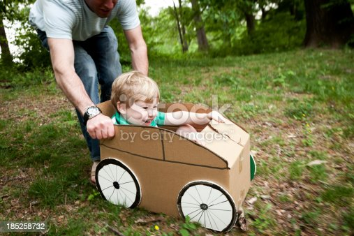 496487362 istock photo Little Boy in a Cardboard Car 185258732
