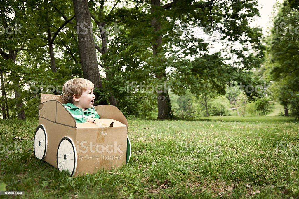 Little Boy in a Cardboard Car royalty-free stock photo