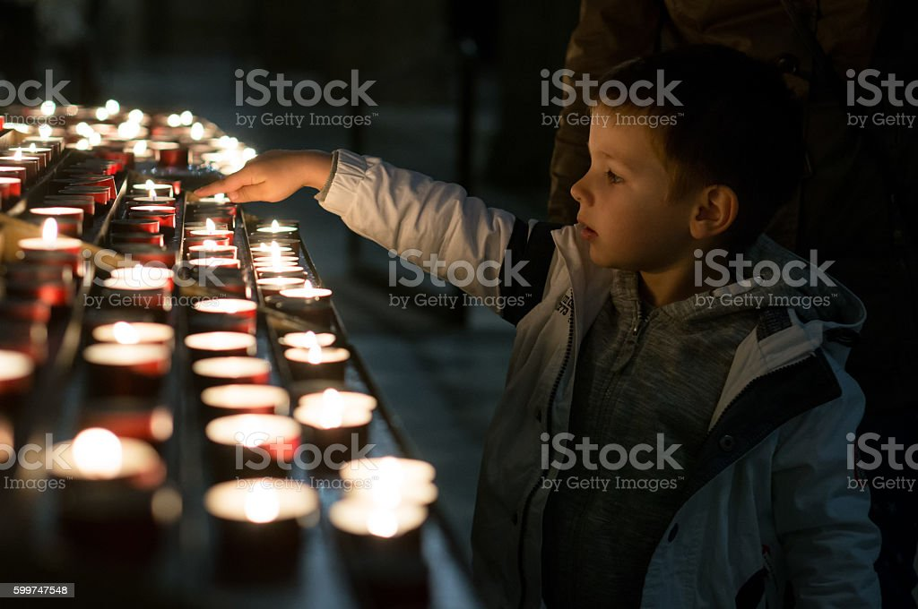 Little boy in a church stock photo