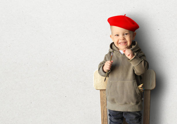 Little boy in a red beret stock photo