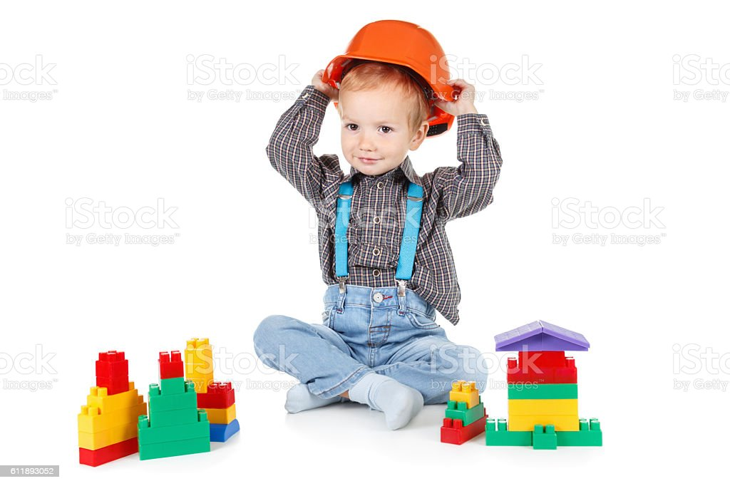 little boy in a red construction hardhat on white background stock photo