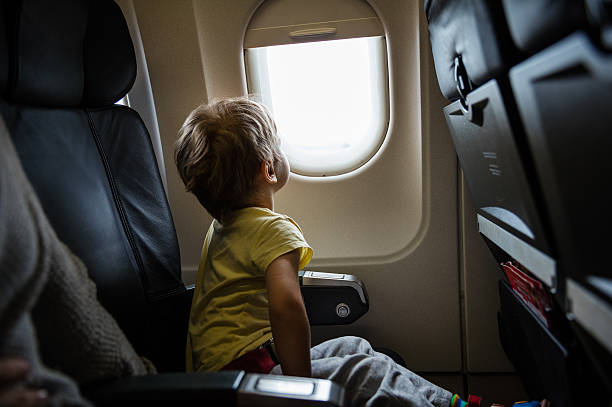 Little boy in airplane stock photo