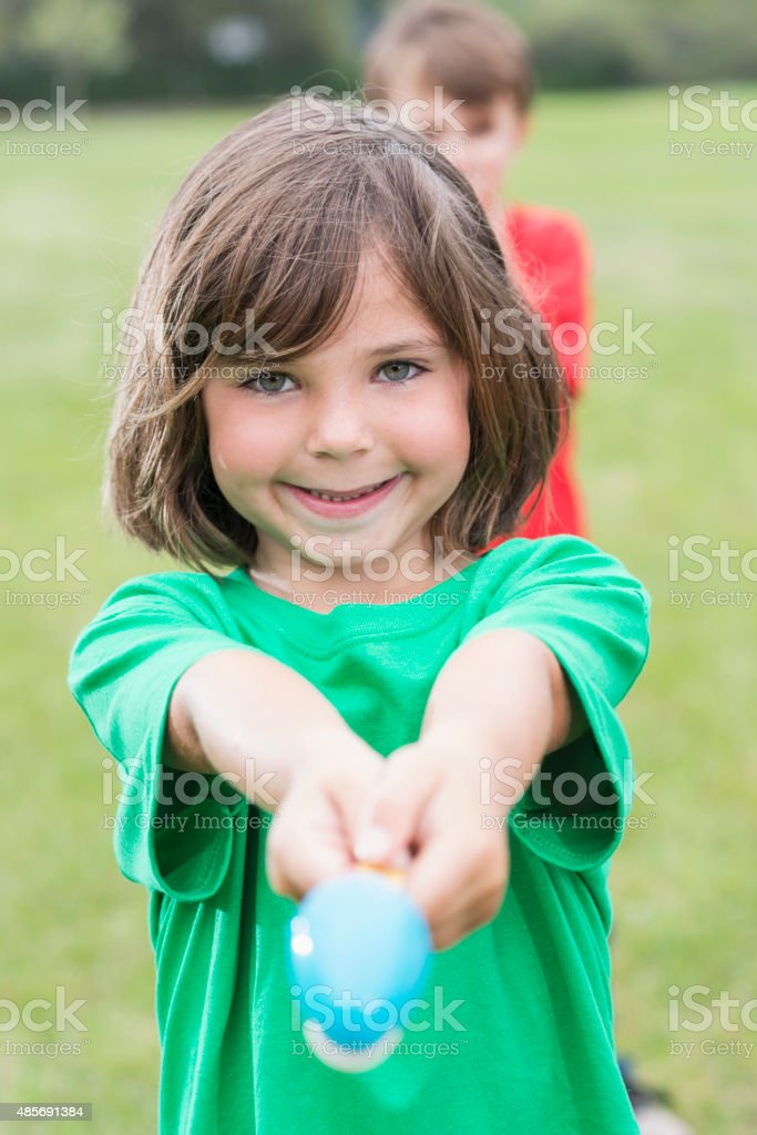 Little boy in an egg spoon race stock photo