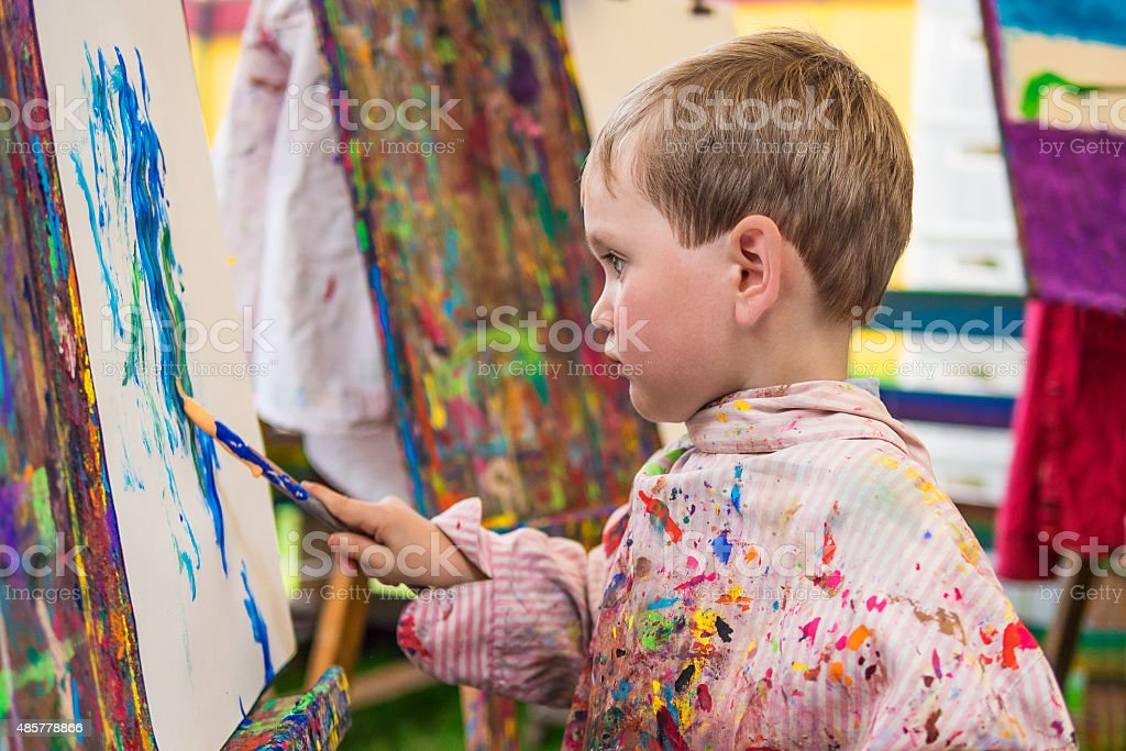 Little boy in art class stock photo