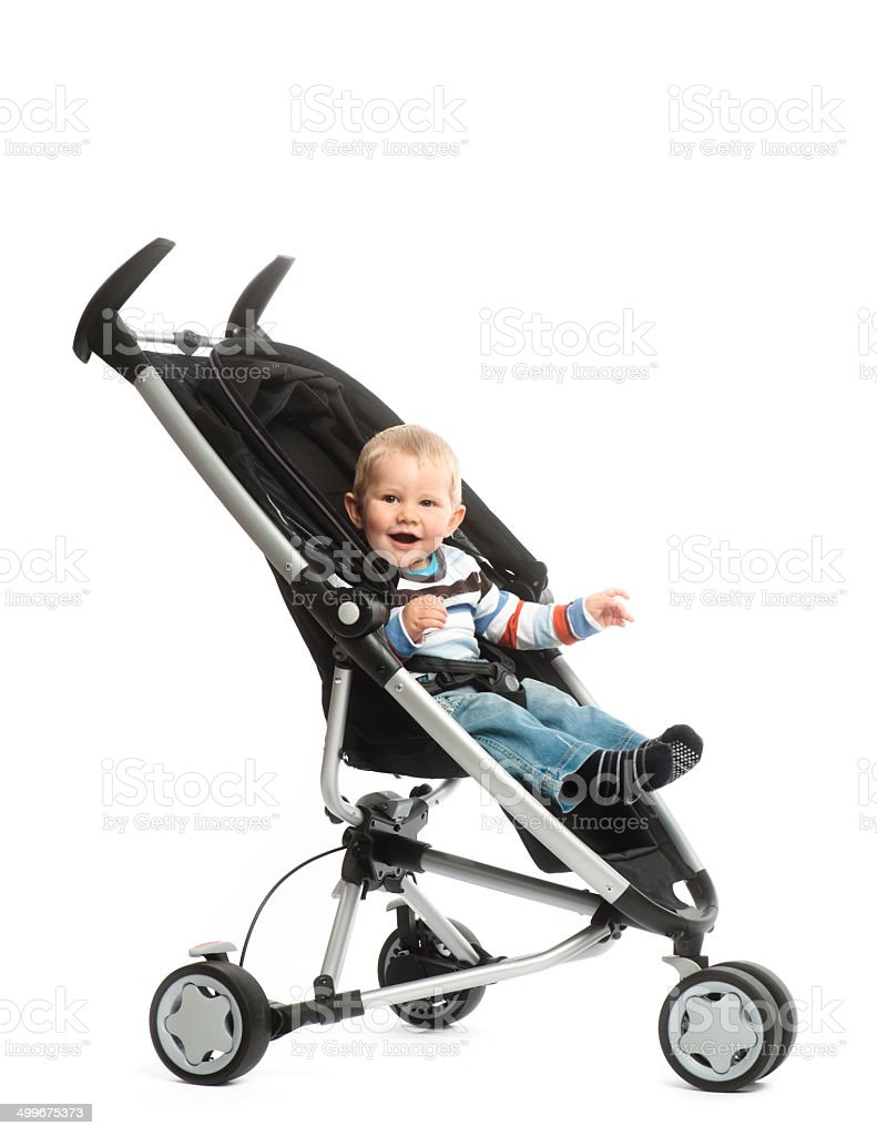 Little boy in baby stroller stock photo