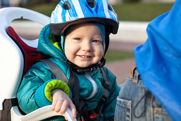 Little boy in bicycle seat stock photo