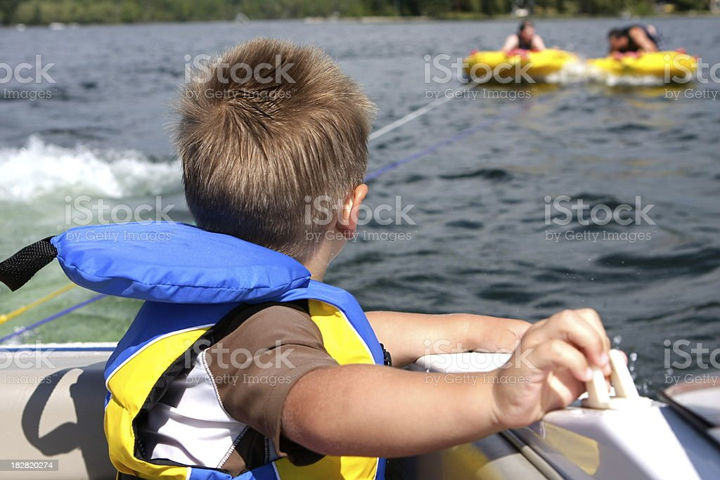 Little Boy in Boat Wearing Life Jacket royalty-free stock photo