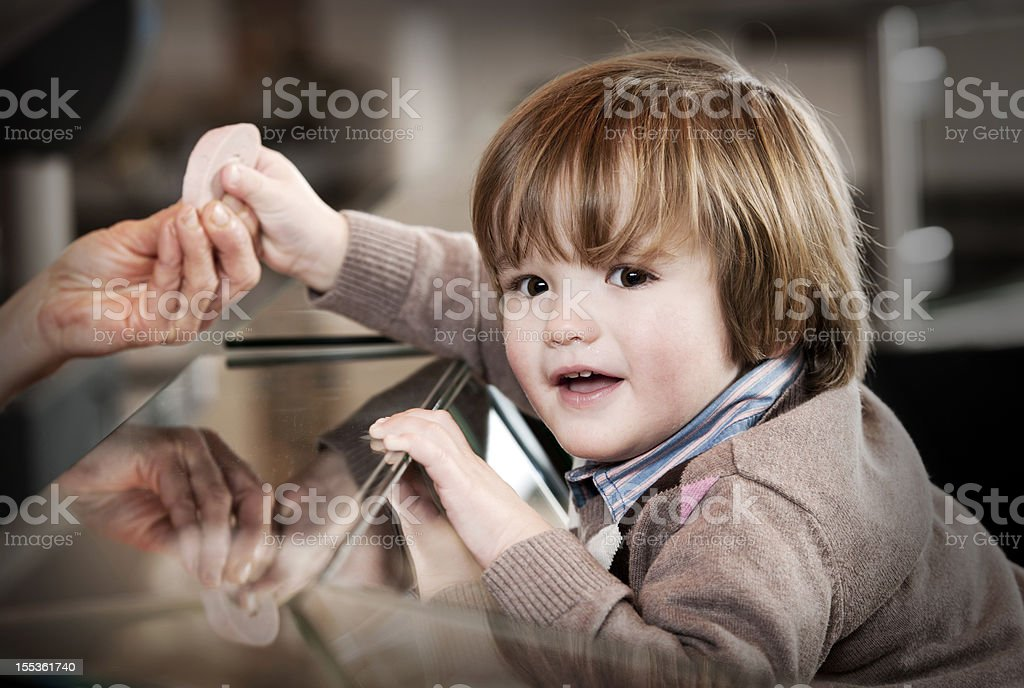 Little boy in butchers shop royalty-free stock photo