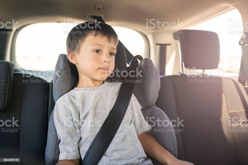 Little boy in car stock photo