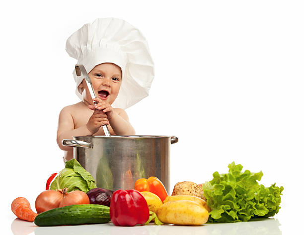 a0e49dd13e1 Little boy in chef s hat with ladle