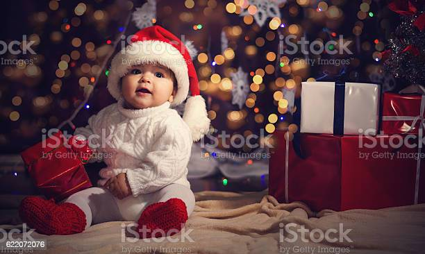 Little boy in christmas santas hat against the backdrop of picture id622072076?b=1&k=6&m=622072076&s=612x612&h=fsut7pno72bteb9n3ngv3wfsj0g5g5n7o5fexnuz8k4=