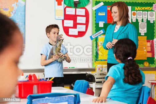 639569206 istock photo Little Boy in Class Showing Dinasaur During Show and Tell 183844766