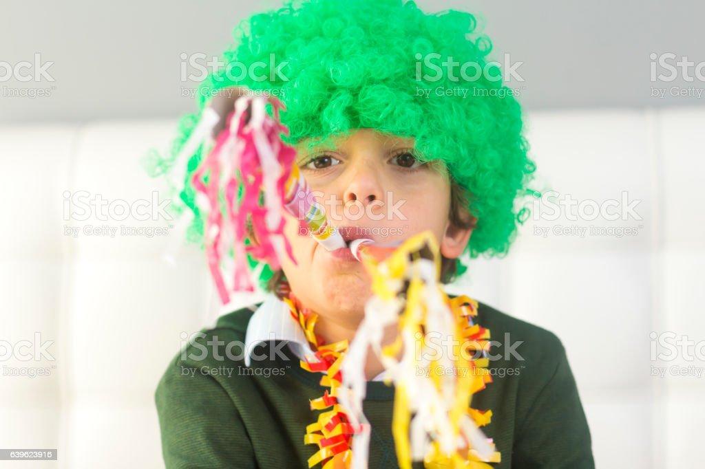 Little boy in clown celebrating birthday stock photo