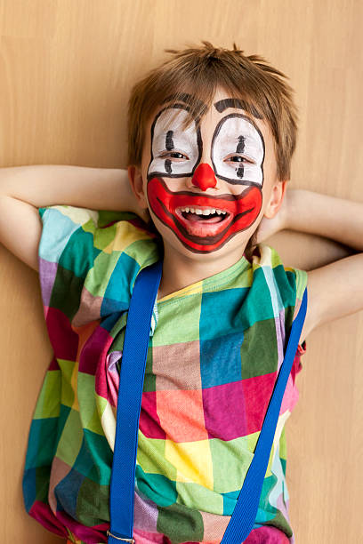 Young man in clown makeup stock image. Image of murder