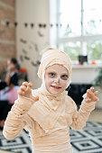 Little boy in costume of mummy having fun on halloween day