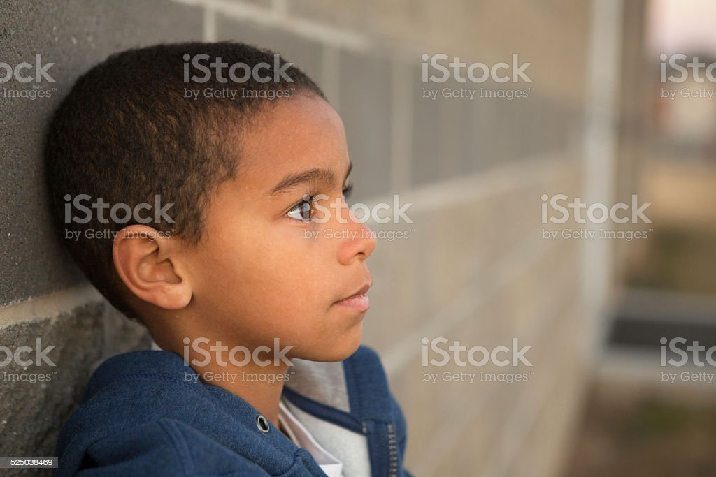 Little Boy In Deep Thought stock photo