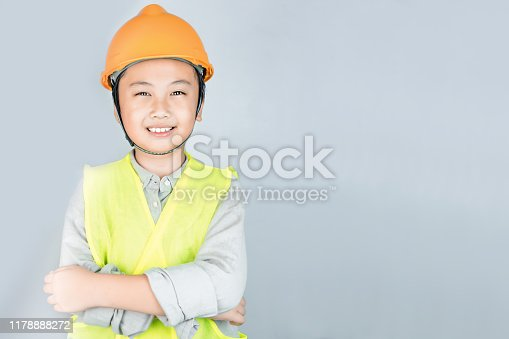istock Little boy in engineering uniform with helmet and copy space 1178888272